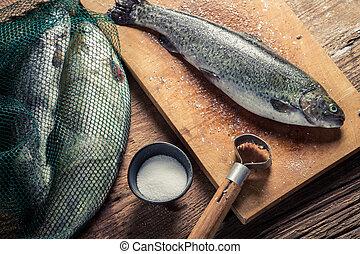 Preparing fish caught in freshwater
