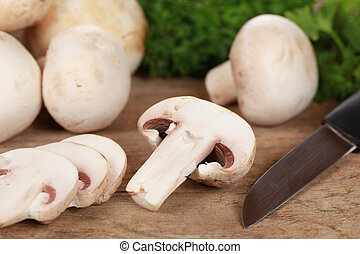 Preparing food: Sliced mushrooms