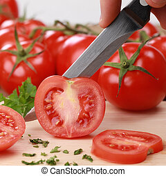 Preparing food: sliced tomato