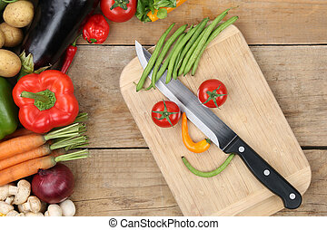 Preparing food smiling vegetables face on cutting board