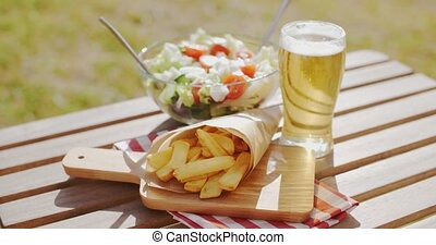 Preparing for a summer picnic with a packet of French fries...