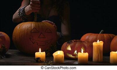 Preparing for Halloween Celebration - Unrecognizable woman...