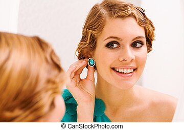 Preparing for holiday - Image of pretty female looking in ...