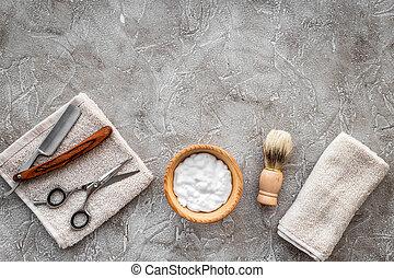 Preparing for men shaving. Shaving brush, razor, foam, sciccors on grey stone table background top view copyspace