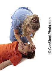 Preparing for resuscitation - A nurse prepares child for...