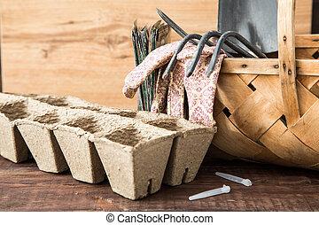 Preparing for spring work, seedlings. Seeds, pots of peat, garden tool
