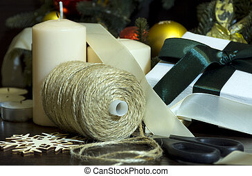 preparing for the holiday, new year, Christmas, spruce branches, spools of thread, scissors, a box with a gift