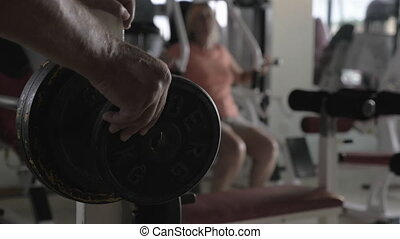Preparing for weightlifting - Slow motion close-up shot of...