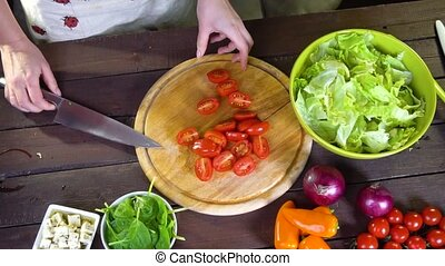 preparing fresh vegetable salad. Slow motion - preparing...