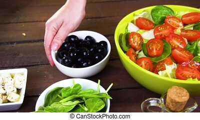 preparing fresh vegetable salad. Slow motion - preparing...