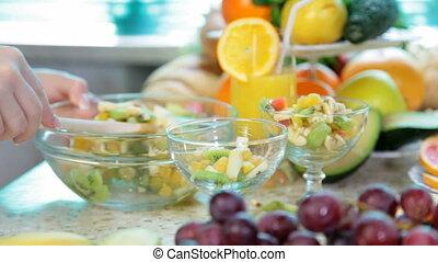 preparing fruit salad in the kitchen
