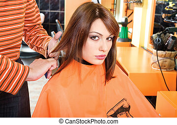 Preparing hair for cutting - Hairdresser preparing hair for...
