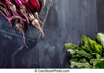 Preparing healthy, vegetarian food on blackboard