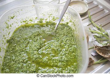preparing homemade pesto sauce