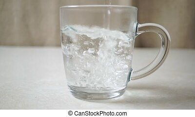Preparing instant coffee with milk in a glass mug