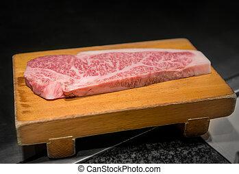 Kobe beef - Preparing Kobe beef, closeup view of steak