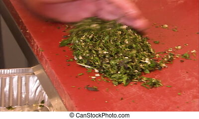 Preparing minced parsley - A close up shot of minced parsley...