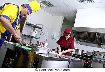 Preparing pastry - Two cooks preparing pastry