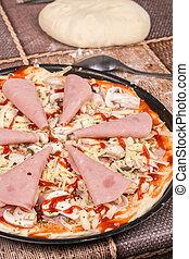Preparing pizza with ham cheese and mushrooms