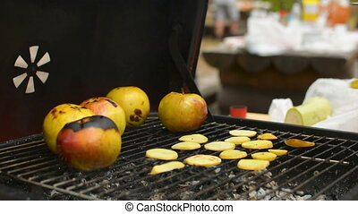 Preparing potato chips and cooking apple closeup during family BBQ grill outside