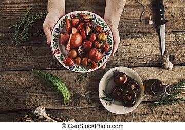 Preparing salad - Healthy food. Chef is preparing vegetables...