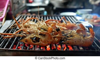 Preparing shrimps at grill. Street Food - Street Food. 4k...