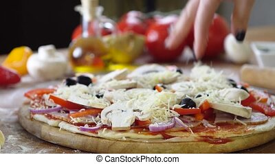 preparing tasty homemade pizza with fresh vegetables