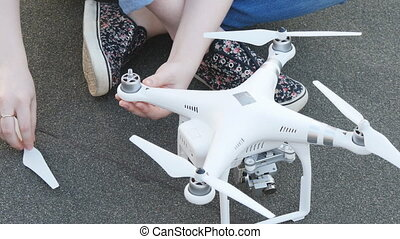Preparing the drone for takeoff. - Preparing the drone for...