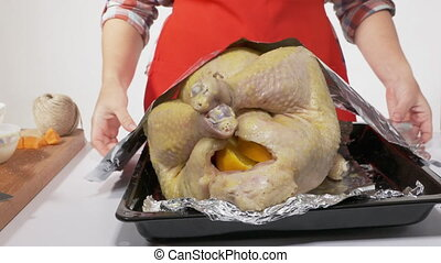 Preparing the Thanksgiving or Christmas turkey for roasting....