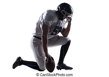 Preparing to big game. Side view of American football player hol
