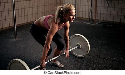 Preparing To Lift Heavy Weight Bar