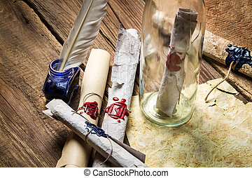 Preparing to send ancient letter in a bottle with blue ink