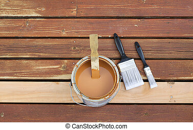 Preparing to Stain Wooden outdoor deck - Horizontal photo of...