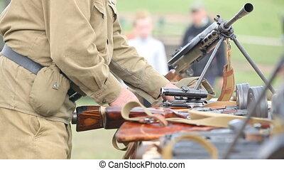 Preparing weapon - Soviet officer preparing weapon for...