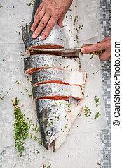 Preparing whole salmon in the summer garden