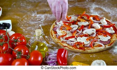 prepearing tasty homemade pizza with fresh vegetables