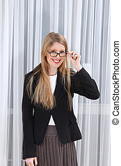 Young preppy girl student in college uniform with eyeglasses