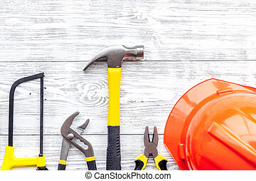 Preraring for home repair. Contruction tools on grey wooden desk background top view copyspace