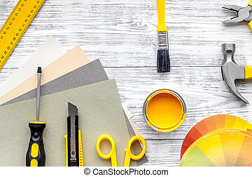 Preraring for home repair. Tools on grey wooden desk background top view copyspace