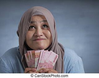 presa a terra, donna, musulmano, rupiah, soldi, indonesiano