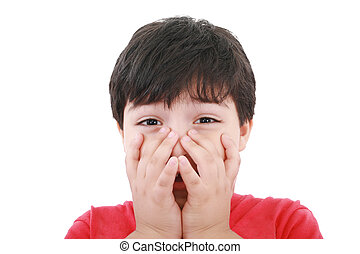 Preschool aged boy with his hand/fists over his mouth; looking embarrassed, worried or unsure. Isolated on white.