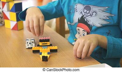 Preschool boy collecting the designer in a nursery -...