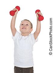 Preschool boy does morning exercises