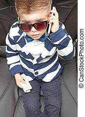 preschool boy sitting in a chair