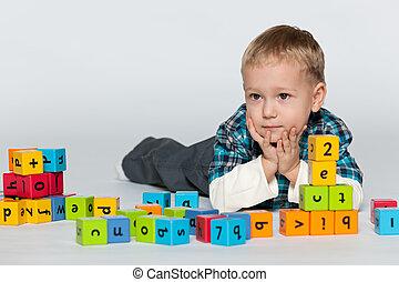 Preschool boy with blocks