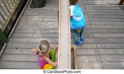 Preschool children play in the playground.