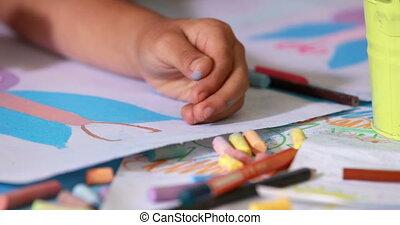 Preschool class drawing at table