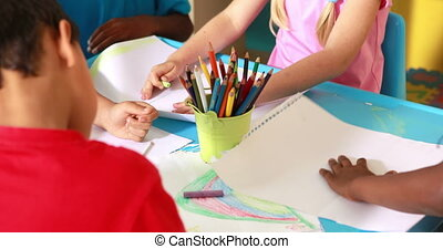 Preschool class drawing at table