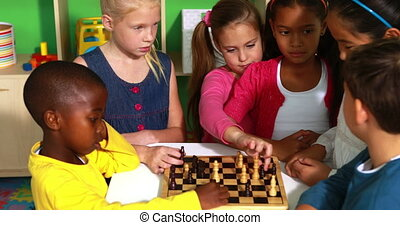 Preschool class learning how to play chess in playschool