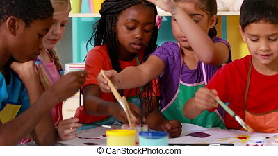 Preschool class painting at table